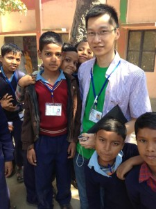 Chris with kids at volunteer placement